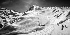 SKi Slopes (Laurent VALENCIA) Tags: snow ski france alps building sports montagne alpes canon buildings woods noiretblanc nb ciel surfers neige foule savoie laplagne matin pistes skieurs frenchalps randonne immeubles sapins glisse