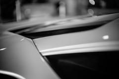 Ferrari 488 GTB, Engine Bonnet side grille (dab458) Tags: leica blackandwhite automobile bokeh ferrari italiancar landtransportation scuderiaferrari bokehlicious italiansportscar carbokeh italianautomobile noctiluxm50mmf095asph leicam240 ferraribyleica ferrari488 ferrari488gtb