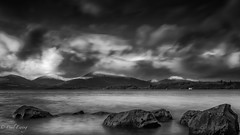 Loch Lomond Rocks (Paul S Ewing) Tags: blackandwhite bw mountain water clouds mono bay scotland moody hills loch lomond milarrochy