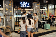 Crab central (Roving I) Tags: retail architecture shopping thailand design eating bangkok hats restaurants dining diners aprons jeansshorts emquartier crabandclaw