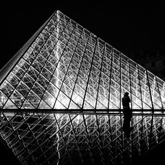 After Hours at the Louvre (Brady Baker) Tags: travel light shadow white black paris france reflection art glass silhouette museum night contrast person pyramid louvre structure lone straggler