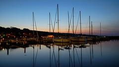 sunset serenity (Elena Berd) Tags: longexposure light sunset sky lake reflection marina landscape boats pier boat waterfront harbour sail fingerlakes nigh senecalake watkinsglen