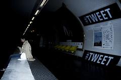 Alone in the Dark (ROYEARS) Tags: street city people paris art canon underground subway eos 50mm waiting metro photos pics april wait m11 texting tweet t3i aprilfool tlgraphe 600d ligne11 twitter 1stapril 1eravril