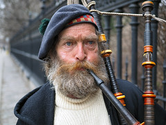 Curly (jeffcbowen) Tags: street toronto scottish stranger curly busker bagpipe thehumanfamily