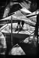 Triangles (The Glass Eye) Tags: nottingham shadow sunlight triangles walking silhouettes february figures awnings 2016