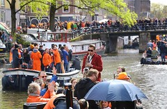 Saxophonist plays a large audience (Bn) Tags: street party feest people music orange holiday holland water netherlands beer colors dutch amsterdam festival heineken boat kiss kissing king singing dancing market smoke free floating bikes kingdom swing canals celebration national trendy muziek carnaval prinsengracht alexander mokum gezellig amstel maxima willem jordaan oranje crowded westertoren straat saxophonist westerkerk wester feestdag grachtengordel saxofonist panden 27april koningsdag kingsday dansmuziek
