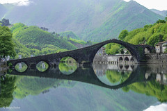 Ponte della Maddalena (seserjio) Tags: bridge sky italy water reflections river italia fiume ponte tuscany maddalena toscana riflessi archi pontedeldiavolo asimmetry