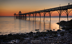 Amber tones (fyule903) Tags: sunset sea england seascape architecture coast pier rocks warm wroughtiron victorian arches somerset coastal clevedon clevedonpier