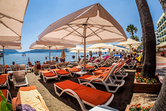 Sea view parasols. (CWhatPhotos) Tags: cwhatphotos people marmaris olympus samyang fisheye fish eye 75mm wide angle prime lens water holiday june 2015 photographs photograph pics pictures pic image images foto fotos photography artistic that have which contain digital bythe bikini blue turkey sea beach wear sand walk sky skies clear day hot sunny sun aegeon aegean turkish hols