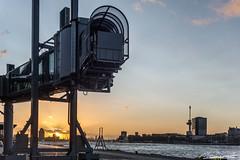 Cruiseterminal bij zonsondergang (dorsman1970) Tags: water zonsondergang rotterdam blauw nederland wolken lucht maas geel zon stad architectuur landschap tegenlicht wilhelminakade cruiseterminal rivier
