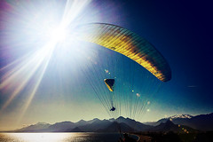 Two and a plane (Melissa Maples) Tags: cameraphone blue winter sea snow mountains beach apple water turkey asia mediterranean trkiye antalya lensflare flare paragliding paragliders parachute sunflare iphone  iphone6 konyaaltzero