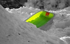 the green sled (karma (Karen)) Tags: snow dof bokeh maryland baltimore neighborhood brightcolors blizzard 4winter sleds selectcolor cmwdgreen