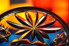 crystal lid of bonbonniere (detail) (1) (HansHolt) Tags: blue light orange flower detail macro glass backlight canon catchycolors gold star licht blauw crystal hmm glas kristal lid oranje tegenlicht bloem 6d goud ster orangeblue deksel bomboniere bonbonniere canonef100mmf28macrousm macromondays canoneos6d 27ccfbt