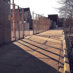 49 | 366: Warily Waring (phillytrax) Tags: city shadow urban usa philadelphia america fence square unitedstates pennsylvania pavement sidewalk pa squareformat metropolis philly chainlinkfence ludwig metropolitan northphiladelphia 215 fenceposts cyclonefence schoolyard northphilly springgarden cityofbrotherlylove schooldistrictofphiladelphia project366 iphoneography instagram instagramapp uploaded:by=instagram laurawaringschool