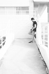 Reflexin eterna. Retratos (adriancasc) Tags: street boy portrait people urban blackandwhite man byn blancoynegro calle gente bokeh retrato ciudad social bn gorra urbano reflexion hombre escaleras