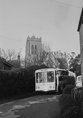 Burgh Le Marsh church and milk float from Church Hill, 1982. (Rotten Kitsch) Tags: building church architecture truck 35mm religion lincolnshire delivery vendor dairy everydaylife mundane milkfloat electricvehicle burghlemarsh
