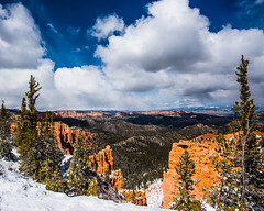 Bryce Canyom 10 (MarcCooper_1950) Tags: trees red sky orange snow colors clouds landscape utah nikon scenery rocks vivid canyon cliffs hills southern boulders hoodoo bryce rainfall hdr formations lightroom mounatins brycecanyonnationalpark geologic d810 marccooper