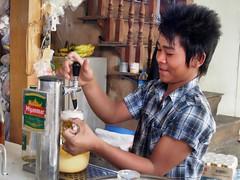 Nyaung Shwe - Myanmar Beer (sharko333) Tags: voyage travel boy people man beer asia asien burma olympus vehicle myanmar inlelake asie birma reise shanstate em5 lakeinle nyaungshawe