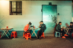 Late Dinner (Jon Siegel) Tags: china street boy people food men girl night dinner dark nikon women moody shanghai cigarette candid 14 chinese culture sigma smoking alleyway mysterious dining 24mm d810 sigma24mmf14art