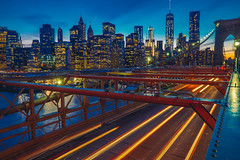 Inspiring Lights of NYC and the Brooklyn Bridge (evmeyerphoto) Tags: nyc longexposure bridge light sunset newyork tower brooklyn freedom downtown skyscrapers manhattan district trails financial fidi