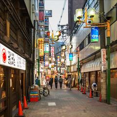 osaka-1387-ps-w (pw-pix) Tags: street people signs japan lights evening workers bars dusk restaurants lane shops pedestrians osaka laneway shinsaibashi shoppers cones witcheshats lookingfordinner