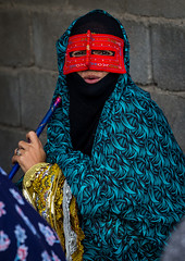 a bandari woman wearing a traditional mask called the burqa at panjshambe bazar thursday market, Hormozgan, Minab, Iran (Eric Lafforgue) Tags: red portrait people woman face vertical outdoors persian clothing asia veil mask iran market smoke muslim islam religion pipe hijab culture persia smoking hidden covered iranian bazaar adults adultsonly oneperson islamic traditionaldress burqa customs ethnicity middleeastern sunni burka chador youngadultwoman balouch hormozgan onewomanonly lookingatcamera burqua  bandari  embroidering 1people  iro thursdaymarket  minab unrecognizableperson colourpicture  borqe panjshambe panjshambebazar iran034i2812 boregheh
