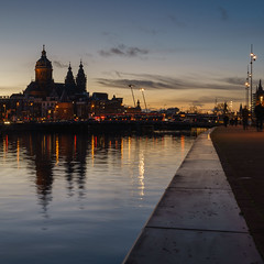 After Sun (McQuaide Photography) Tags: old city winter light urban holland reflection church water netherlands dutch amsterdam skyline architecture zeiss photoshop outside licht twilight dock lowlight europe waterfront harbour outdoor dusk basilica sony tripod capital nederland 11 adobe squareformat bluehour fullframe alpha prinshendrikkade kerk waterside squarecrop stad manfrotto noordholland lightroom oosterdokskade capitalcity 1635mm northholland a7ii variotessar religiousbuilding mirrorless sonyzeiss basilicaofsaintnicholas basiliekvandeheiligenicolaas mcquaidephotography ilce7m2