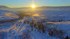 Epic Sunshine (Dan Beland) Tags: sunset usa sun sunlight mountains art nature sunshine forest landscape unmodified haze unitedstates offroad artistic snowy bluesky hills idaho lensflare vista northamerica rockymountains backroad epic baretrees pinetrees snowcovered sunflare clearblueskies unedited mountainscape drone nofilters bitterrootmountains noadjustments dji beaverheadmountains straightoffthecamera lemhimountains quadcopter lemhivalley illuminatedlandscape phantom3professional kirtleycreekroad