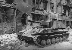 Soviet SPG SU-76M on one of the ruined streets of Berlin.