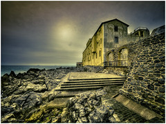 Coastline Cefal (Luc V. de Zeeuw) Tags: sea italy sun water yellow facade rocks cloudy sicilia cefal