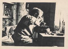 Man working on repairing a clock (simpleinsomnia) Tags: old white man black clock monochrome vintage found blackwhite antique watch snapshot photograph workshop vernacular maker foundphotograph watchmaker