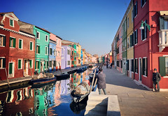 Burano is so colorful, like opening up a new box of coloring pencils. It instantly makes you happy as a child (VillaRhapsody) Tags: bridge venice houses winter italy water colors buildings reflections boats island canal colorful colours footbridge colourful venezia venedig burano pedestrianbridge archbridge citytrip