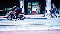 Horsepower Vs. Pedal Power (TMimages PDX) Tags: road street city people urban bicycle buildings portland geotagged photography photo image streetphotography streetscene sidewalk photograph pedestrians motorcycle pacificnorthwest avenue cinematic vignette fineartphotography iphoneography
