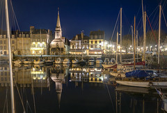 """perfect night reflections of Quai St Etienne, Honfleur, Normandy, France (grumpybaldprof) Tags: old bw france colour reflection monument water stone architecture port buildings reflections boats lights mirror town ancient bars sailing harbour ships sails restaurants historic mooring normandie honfleur yachts picturesque normandy quai halftimbered collombage quarantaine """"quaistecatherine"""" """"quaistetienne"""" """"lalieutenance"""" """"oldharbour"""" """"vieuxbassin"""" """"quaiquarantaine"""" """"stecatherine"""""""