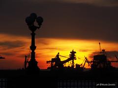 SUNSET FIRE (NIKOZAR (Nicola Zaratta)) Tags: sunset primavera italia olympus lungomare puglia taranto olympusomdem10 olympusomdem10ii