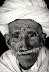Old Rajasthani man, India (Dietmar Temps) Tags: people blackandwhite india colors 50mm eyes faces traditional culture naturallight oldman ritual turban tradition elders ethnic wrinkles bikaner jaisalmer rajasthan jodhpur ethnology thardesert ethnie nationalgeographicfacesoftheworld