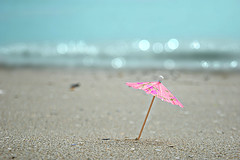 the beach (marina romea - ravenna, italy) (bloodybee) Tags: pink blue sea italy brown beach water umbrella paper fun sand europe bokeh humor adriatic ravenna marinaromea 365project