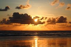 A little peace of mind (Angelina.Maria) Tags: ocean light sunset sun seascape beach clouds oregon pacificnorthwest oregoncoast rays cannonbeach