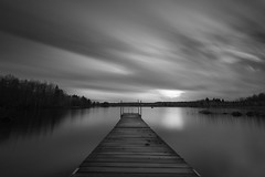In a lonely place (jarnasen) Tags: longexposure trees sky blackandwhite bw lake nature water monochrome clouds landscape mono wooden nikon noiretblanc cloudy sweden outdoor jetty smooth himmel wideangle le sverige nikkor scandinavia landskap sj svartvit stergtland movingclouds ndfilter d810 leefilters nd10 nordiclandscape bigstopper 1635mmf4 lillarngen