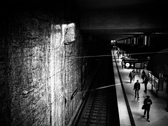 Munich subway station (Sandy...J) Tags: street shadow people urban bw white man black station silhouette wall germany dark underground walking subway munich mnchen bayern deutschland photography mono blackwhite waiting noir fotografie darkness metro walk wand streetphotography atmosphere tunnel olympus menschen stadt ubahn wait sw mann monochrom passage atmosphre stimmung mauer bavarian gehen dunkelheit warten schwarzweis strasenfotografie