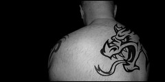 The dragon does enter. (CWhatPhotos) Tags: pictures camera portrait man male face look tattoo digital ink self pose dark naked nude that four photography back eyes foto image artistic pics body bare chest curves picture pic olympus it images tribal tattoos have upper photographs photograph fotos warrior torso shoulders curved shoulder across which contain omd thirds inked selfie tatt tatts tattooed tattooo em10 selfee cwhatphotos
