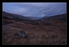 Moonrise, Glen Lyon, Scotland (spodzone) Tags: road old longexposure light people moon colour art nature beautiful lines composite composition manipulated lens landscape photography scotland raw dynamic emotion affection dusk transport perthshire thoughtful places rules calm boulder equipment zen receding vista balance beyond serene bluehour colourful moment idyll favourite awe striking fleeting distance pure contrasts inviting tranquil hdr rugged contentment elegance windingroad timing uplifting transience rockstone nearfar timelessness glenlyon skyearth shapeandform calmstill sony1855 mankindnature nearmidfardistance