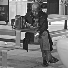 DSCN4708 (Akbar Simonse) Tags: street people man holland netherlands bench bag square glasses sitting candid nederland streetphotography cellphone bank smartphone mobilephone tas bril vierkant straatfotografie akbarsimonse dscn4708
