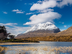 Loch Clair and Liathach (Highlandscape) Tags: blue trees winter sky snow mountains weather clouds river reeds landscape scotland highlands estate outdoor peak olympus glen hills features loch markii torridon munro 2016 liathach beinn eighe beinneighe coulin glentorridon em5 a896 coulinestate httphighlandscapezenfoliocom olympusem5markii aghairbe