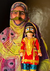 a bandari woman wearing a traditional mask called the burqa with a decorated doll for nowruz festival, Qeshm Island, Salakh, Iran (Eric Lafforgue) Tags: people woman face vertical shop outdoors design persian clothing asia doll veil mask iran muslim islam religion hijab culture persia womenonly hidden covered taylor iranian adults trade adultsonly oneperson islamic traditionaldress burqa customs ethnicity middleeastern frontview persiangulf sunni nowruz qeshmisland burka chador hormozgan onewomanonly lookingatcamera burqua middleagedwoman إيران bandari иран 1people イラン irão straitofhormuz 伊朗 colourpicture 이란 salakh borqe boregheh irandsc04379