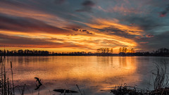 Strike of light (piotrekfil) Tags: sunset sky sunlight lake reflection nature water clouds landscape twilight pentax dusk poland waterscape piotrfil