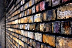 Aligned (Andrea Kennard) Tags: wood windows light texture lines metal architecture doors colours shadows patterns bricks curves warehouse plastic grids gravel