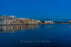 By the ocean... (Syahrel Azha Hashim) Tags: ocean travel light vacation holiday detail reflection building architecture 35mm buildings prime colorful exterior dof getaway sony horizon naturallight bluesky malta bluehour shallow simple dramaticsky mediterraneansea clearsky birzebbuga meditteranean 2016 a7ii colorimage sonya7 syahrel ilce7m2