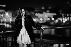 Sera on the Streets of Amsterdam (Hans van Eijsden) Tags: portrait blackandwhite bw woman netherlands girl monochrome beauty amsterdam lady female standing outside blackwhite model bokeh outdoor longhair makeup posing personality backlit nl youngadult lowkey oneperson noordholland greyscale darkhair individuality individuals elinchrom elb400