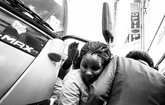 Awoman squeezes through a tight space between a bus and other pedestrians in the crowded streets of Nairobi's Central Business District. (Matt Wicks / GreatDistances) Tags: 2015 africa bw eastafrica kenya nairobi nairobicbd nairobicentralbusinessdistrict pentax ricoh ricohgr ricohgrv autobus blackandwhite bus busy candid crowded horizontal streetphoto streetphotography transportation woman women